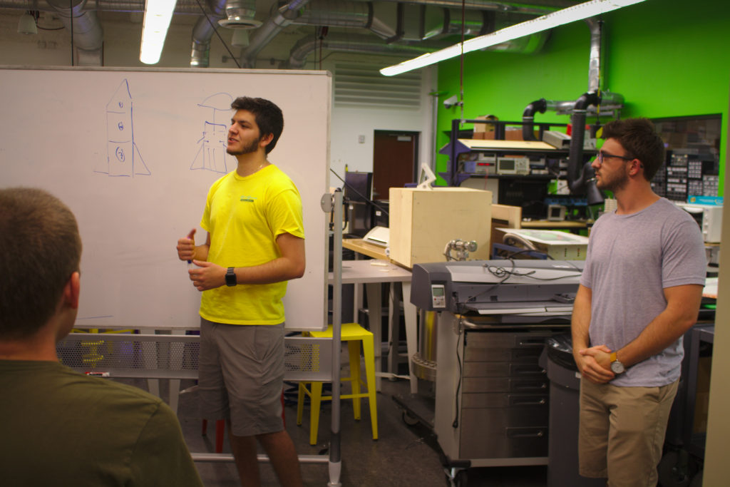 Jaime (left) and Nick (right) lead a mechanical engineering design meeting